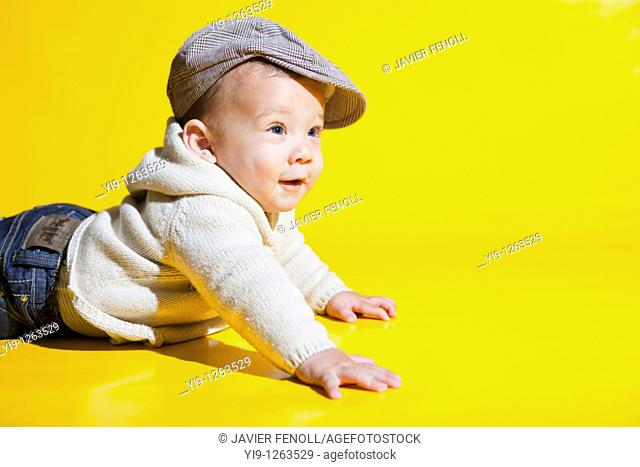 Studio shot of Caucasian baby wearing hat