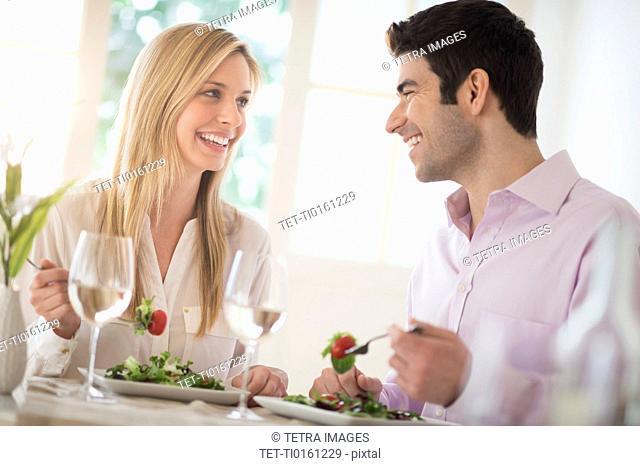 Couple eating dinner in restaurant