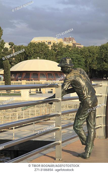 Azerbaijan; Baku, Bulvar, Cafe Rast, fisherman statue,