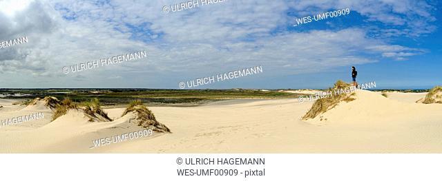 Denmark, Jutland, woman enjoying the view at Rabjerg Mile shifting dune