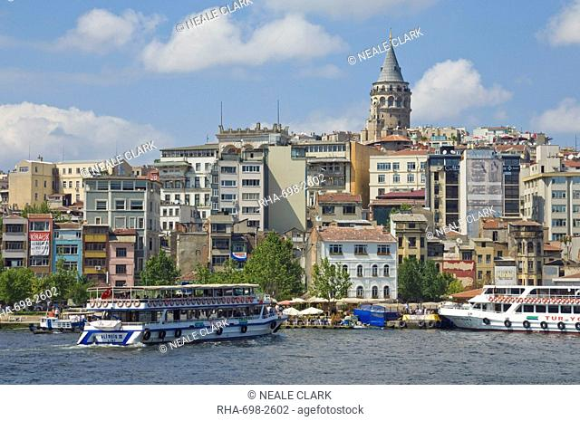 The Galeta tower Galeta Kulesi , a former watchtower built in 1348, Beyoglu district, with a ferry crossing the Golden Horn, central Istanbul, Turkey, Europe