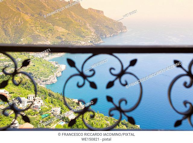 Amalfi Coast, Italy, a table for two, a summer hat and two glasses of white wine with the seaside panorama