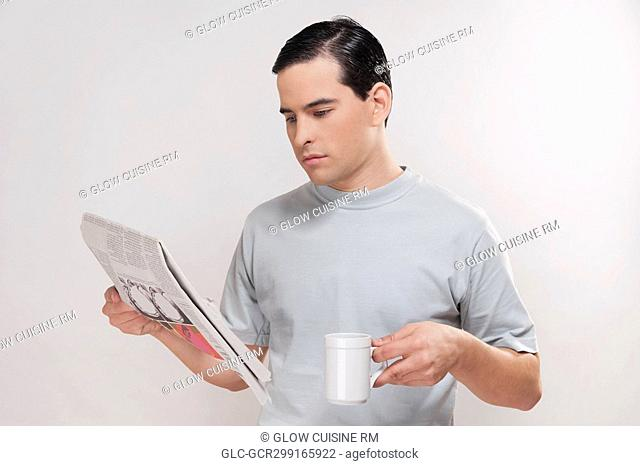 Close-up of a man reading a newspaper