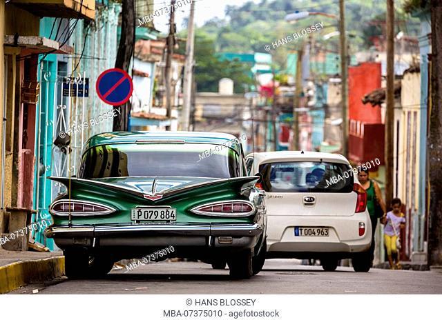 Vintage car, historic road cruiser, green impala, streetlife in downtown Santa Clara at the Parque de Santa Clara, Villa Clara, Cuba