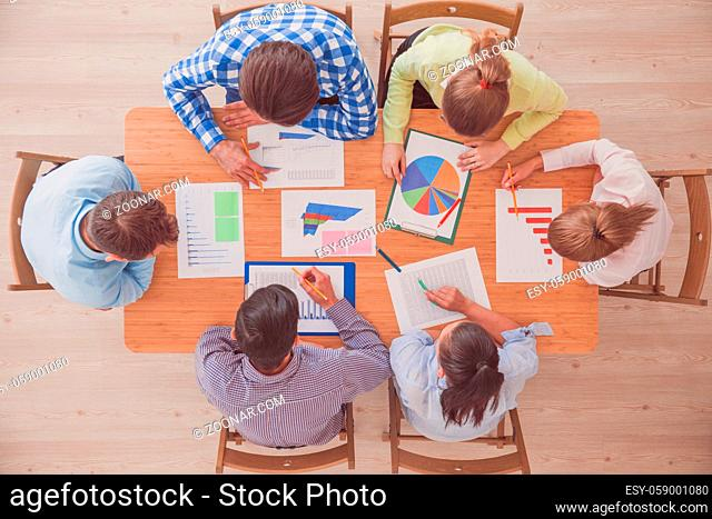 Group of multiethnic busy people working in an office, top view