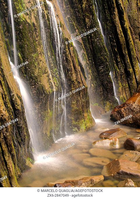 Cascade of Ason river at its source. Collados del Ason Natural Park.It is a limestone massif whose most characteristic features are derived from glacial action...