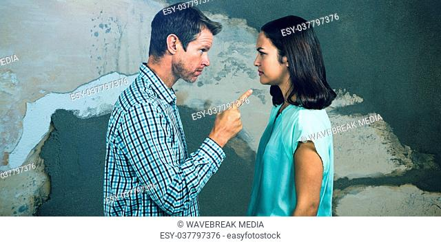 Composite image of side view of man pointing woman while arguing
