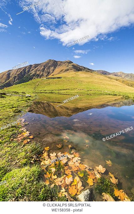 A puddle under the summit of Bregagno mount. Musso, Como lake, Lombardy, Italy
