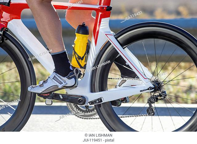 Close-up of female cyclist foot on pedal of race bicycle