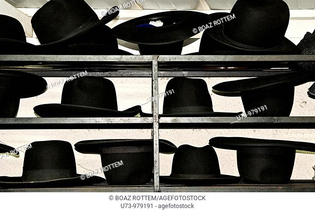 Hats in order.Orthodox Jewish men that pray and learn the bible keep their traditional hats on the shelf