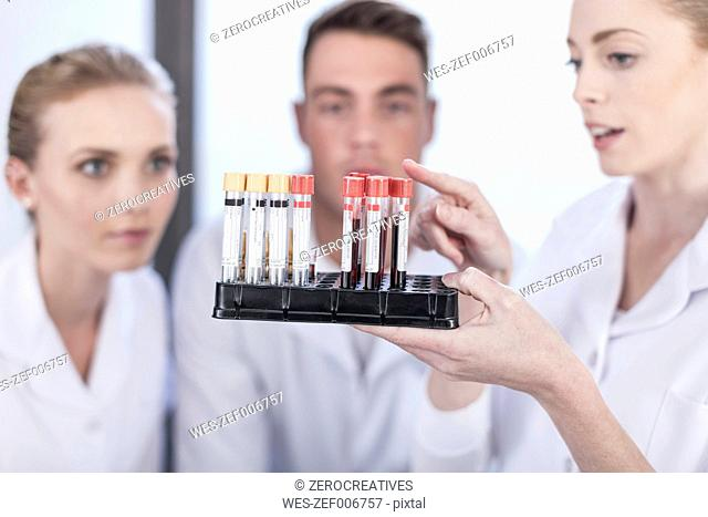 Nurse educating young colleagues