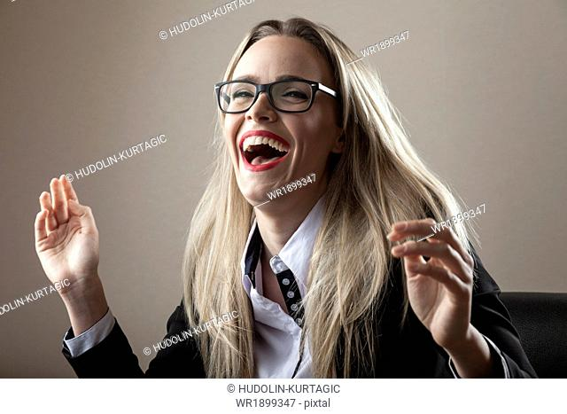 Businesswoman laughing cheerfully