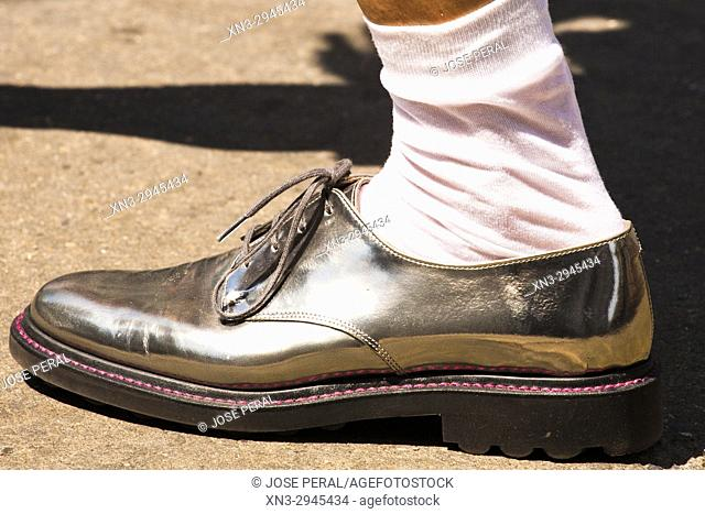 Man with silver shoe, with laces and white socks