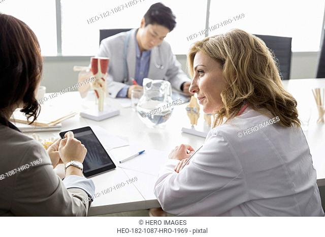Doctors meeting in conference room