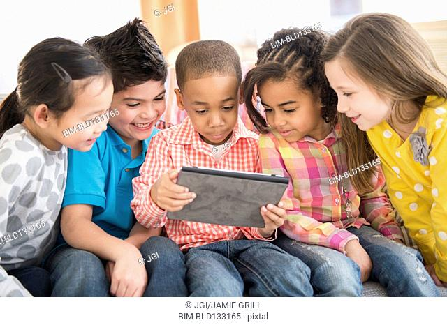 Children using digital tablet together