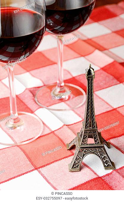 Souvenir Eiffel towe and a pair of wineglasses on the table