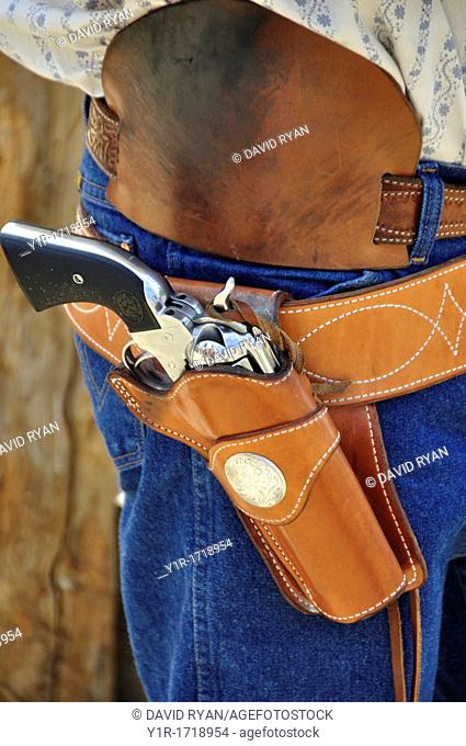 Close up of a holserd Colt style 45 single-action revolver at a fast draw competition, Pioneer Days Celebration in Idaho City, Idaho, USA