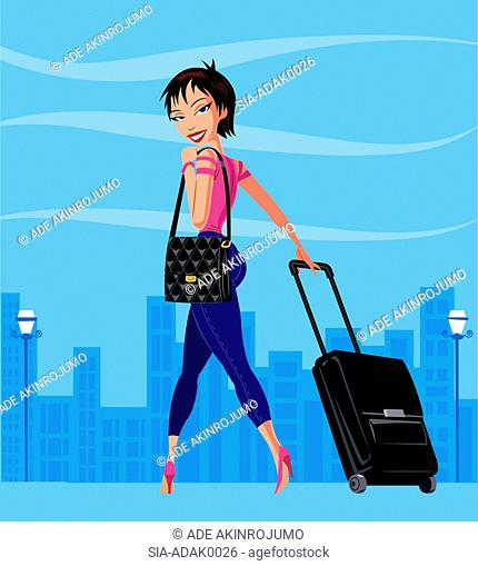 Woman in city with wheeled suitcase