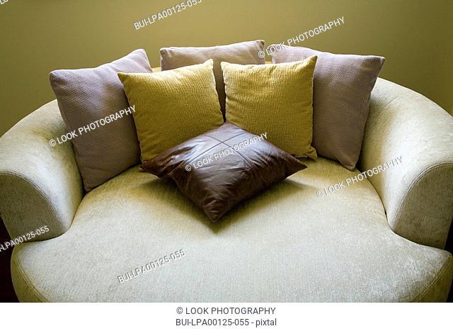 Circular sofa bed with throw pillows