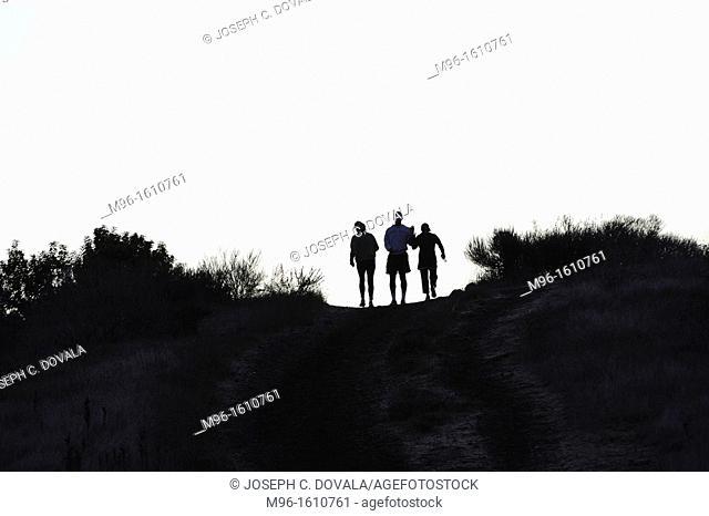 Joggers greet coach on hill, Thousand Oaks, California, USA