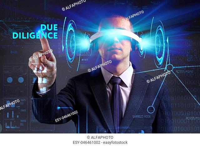 Business, Technology, Internet and network concept. Young businessman working in virtual reality glasses sees the inscription: Due diligence