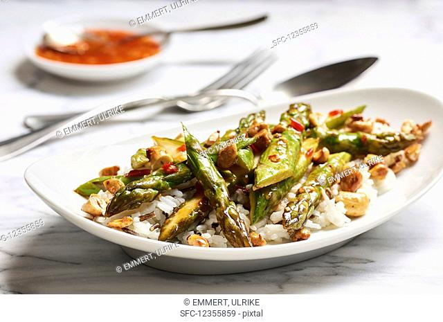 Fried green asparagus in sweet and spicy sauce with cashews on basmati and wild rice