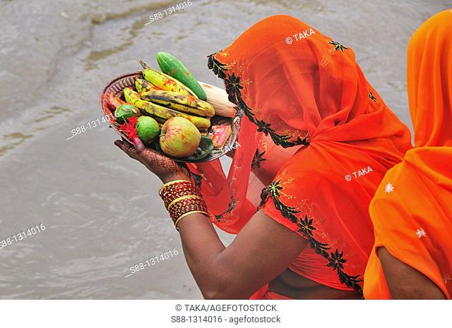 Woman devote fruits to the God by the Bagmati river
