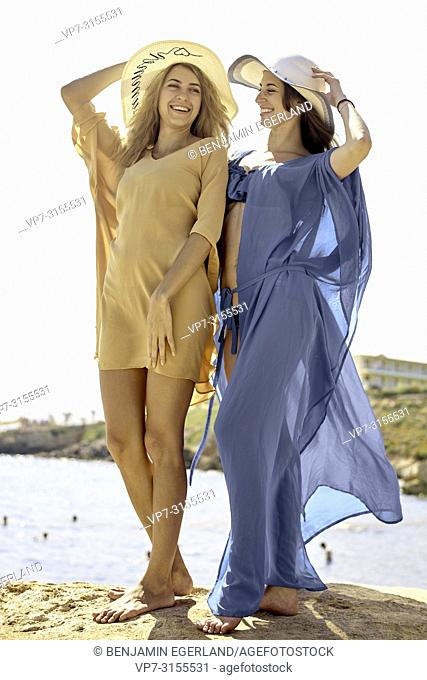 Two women by the sea, Crete, Greece