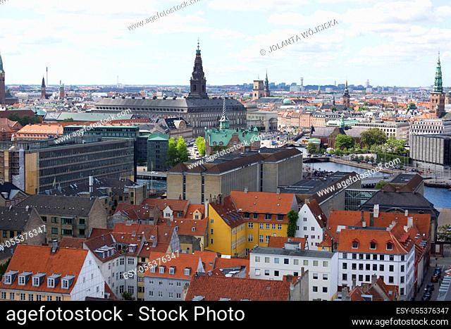 Copenhagen, Denmark - June 22, 2019 : Aerial view on the city from the spiral tower Church of Our Saviour. Christiansborg Palace
