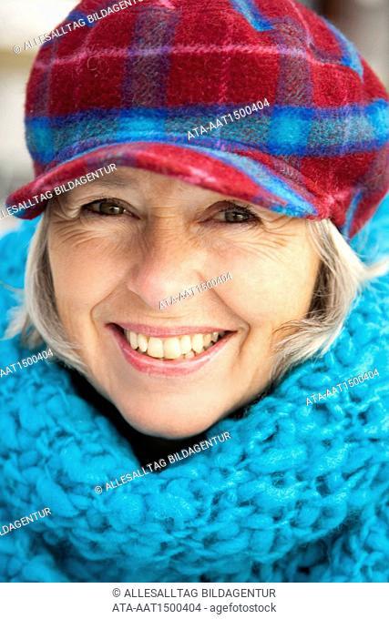Elderly person with cap, portrait
