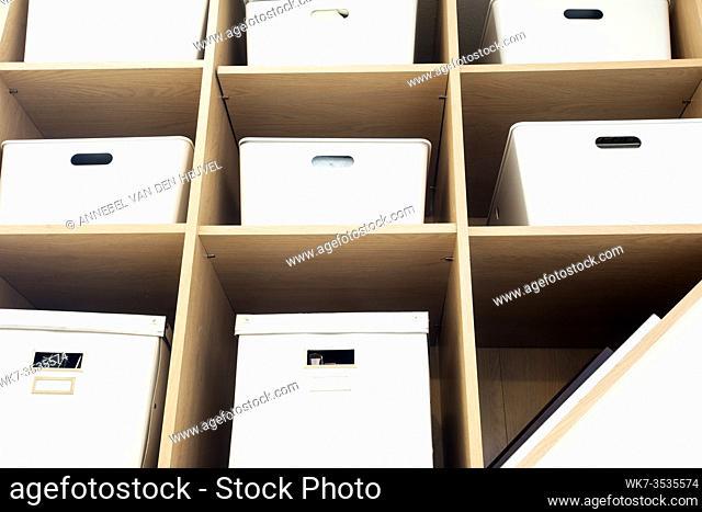 Modern interior white boxes in wooden shelfs for storage, modern interior clean up organized