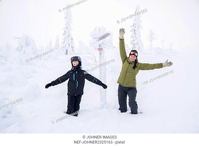 Mother with son in snow
