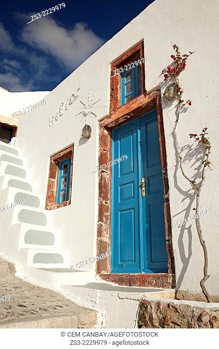 Entrance of a Cyclades house with a blue door and blue windows, Oia, Santorini, Cyclades Islands, Greek Islands, Greece, Europe