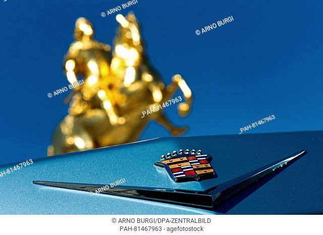 The emblem of a Cadillac (series 62) seen in front of the 'Goldener Reiter'(Golden Ride) statue during a photocall for the USCar Convention inDresden
