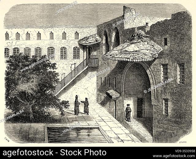 Courtyard of a traditional house in the old Syrian city of Hama, Syria, Syrian Arab Republic. Middle East, Old 19th century engraved illustration