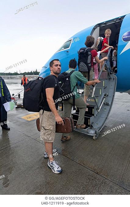 Man boarding small plane