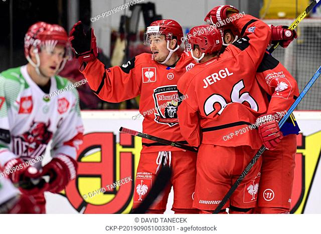 From left hockey players RUDOLF CERVENY, ALES JERGL, TOMAS VINCOUR of Hradec Kralove celebrate a goal during the Champions Hockey League H group game: Hradec...