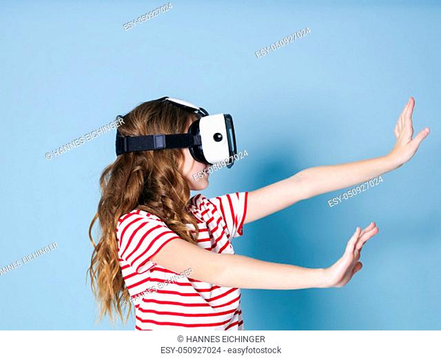 smiling positive girl wearing virtual reality glasses goggles headset, vr box. connection, modern, new generation, concept