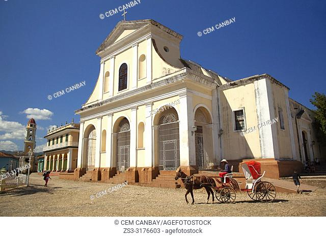 Horse-carriage in front of the Iglesia de Santisima Trinidad- Holy Trinity Church, Museo Romantico and Museo Nacional de la Lucha contra Bandidos at the Main...