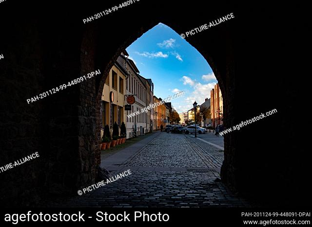 04 November 2020, Brandenburg, Bernau: View through the stone gate in Bernau (Brandenburg) in direction of the city centre
