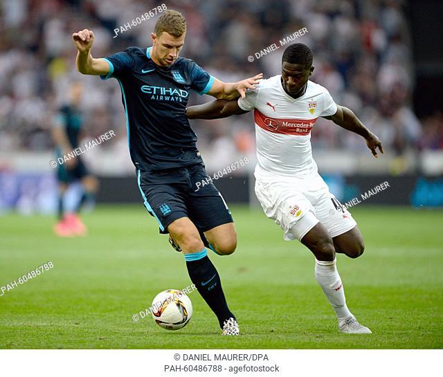 Stuttgart's Stephen Sama (R) and Manchester's Edin Dzeko vie for the ball during a friendly between German Bundesliga soccer club VfB Stuttgart and England's...