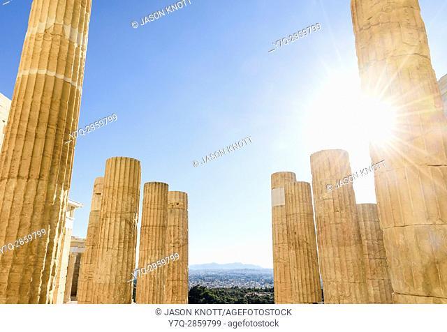 Sun shines through the columns of the Propylaea, the grand entrance to the Acropolis, Athens, Greece