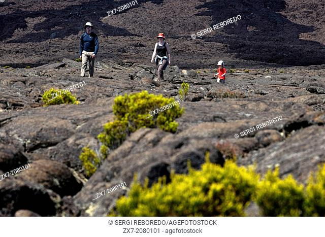 One family making a trek over the lava of volcano Piton de la Fournaise. It is the only active volcano on the island. Its eruptions attract thousands of...