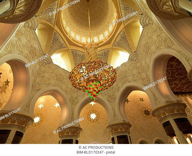 Low angle view of chandelier in ornate dome, Abu Dhabi, Abu Dhabi Emirate, United Arab Emirates