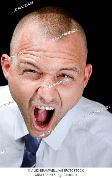 An angry businessman with a Mohican haircut