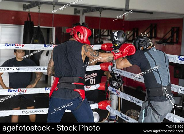 CANCUN, MEXICO - OCTOBER 20: Alexis Bastar (L) and Joselito Velazquez (R), boxing fighters training in the ring to prepares their bodies and improve their...