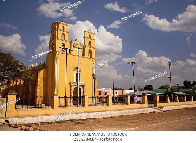 Young men in front of the church at the town center, Acanceh, Convent Route, Yucatan Province, Mexico, Central America