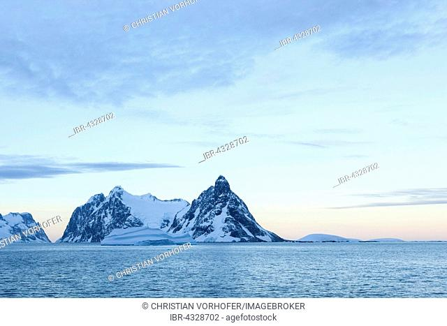 Morning atmosphere, Snowy mountains with ice and glaciers, Antarctic Peninsula, Antarctica
