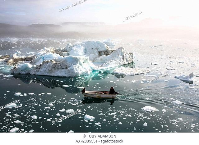 Greenland, Fisherman going out to sea; Ilulissat