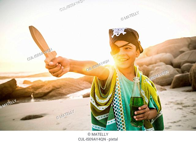 Boy playing pirate on beach